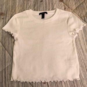 A white  ruffled edge T-shirt.